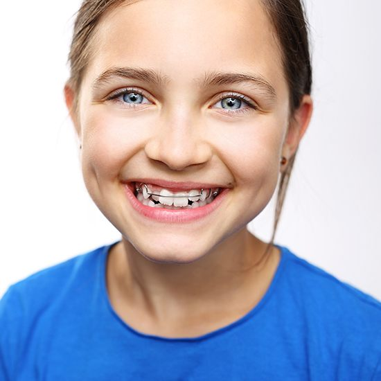 Smiling girl with orthodontic appliance