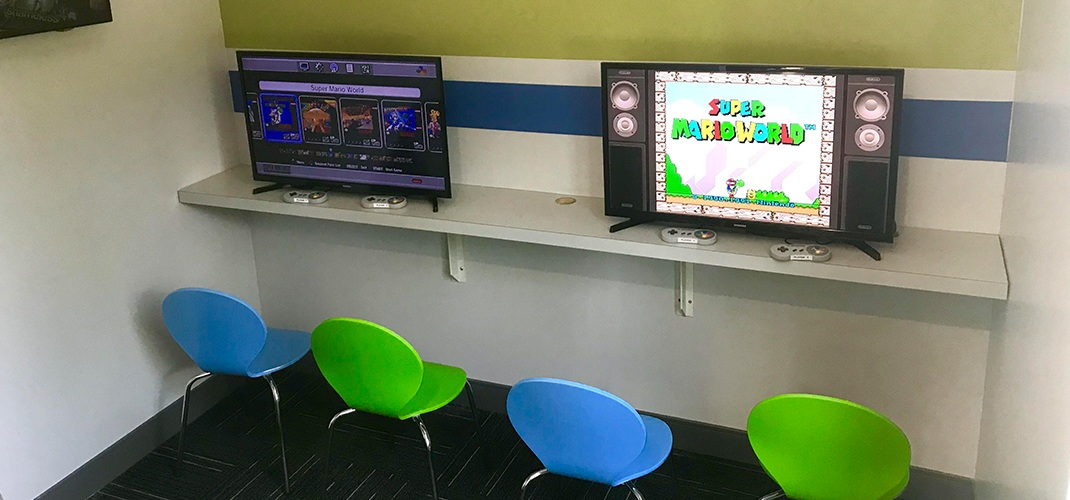 Kid friendly gaming area in orthodontic office waiting room