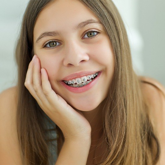 Smiling teen girl with self ligating braces