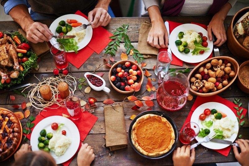 Aerial shot of friends enjoying holiday feast